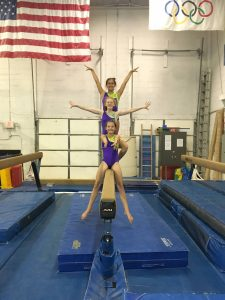 Jets gymnasts on balance beam